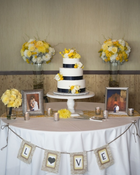 yellow flowers and wedding cake table